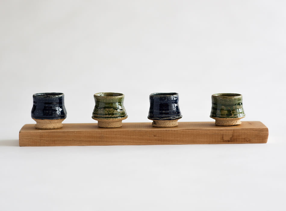Saki Cups on Wooden Base by Geoffrey Healy Ceramic Artist
